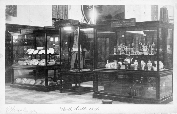 The relics of George Washington on exhibit as part of the Ethnology exhibit in the North Hall of the United States National Museum, 1891 (now the Arts and Industries Building). Washington's relics were one of the earliest collections of the United States National Museum