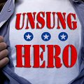 Man wearing T shirt with Unsung Hero on it