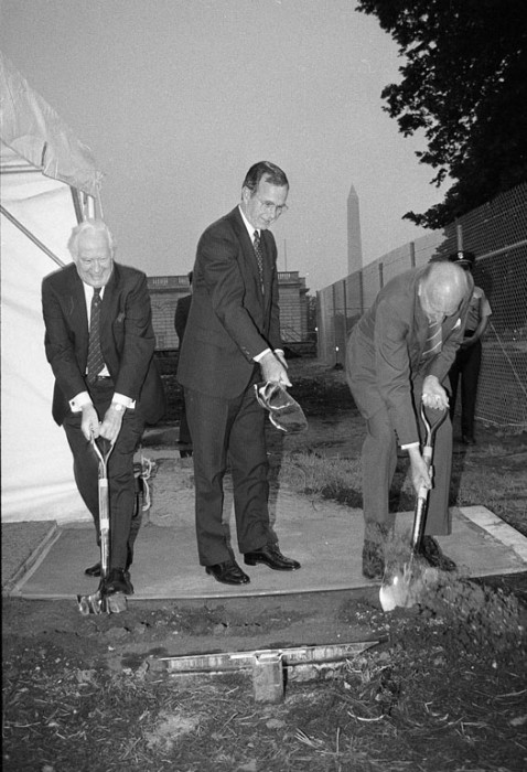 Chief Justice Warren E. Burger, Vice President George Bush, and Secretary S. Dillon Ripley at the groundbreaking ceremony for the Quadrangle Complex, June 21, 1983. The Washington Monument is visible in the background.
