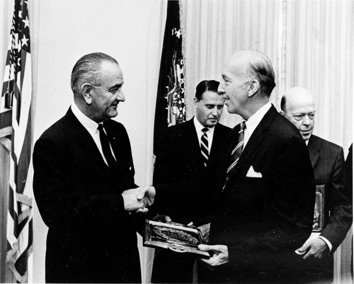 President Lyndon Baines Johnson presents a plaque symbolizing the Smithsonian Institution's 1966 Safety Award to eighth Secretary of the Smithsonian Institution (1964-1984) S. Dillon Ripley (1913-2001) at the White House on June 13, 1967. In the background are representatives of the other two winning agencies, the Federal Aviation Administration and the Department of the Navy. (Photographer unknown, as featured in the Torch, July 1967)