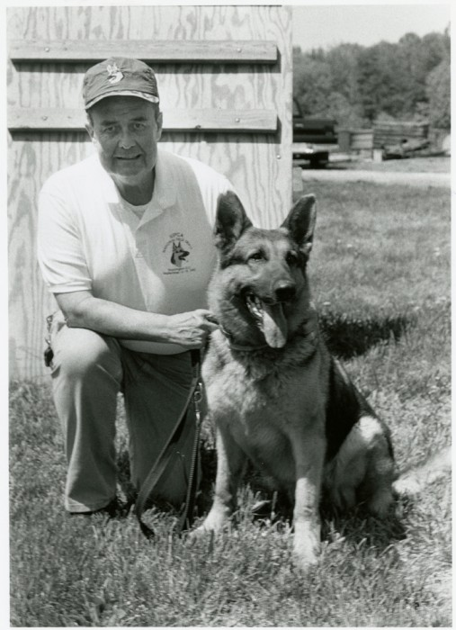 Don Bartel, trainer for the Smithsonian Institution's Office of Protective Services K-9 Unit, with Major, one of the K-9 Unit's finest. (Photo by Diane Nordeck, as featured in the Torch June, 1994)