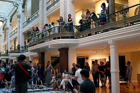 Appreciative music and art lovers line the mezzanine at the Luce Foundation Center.