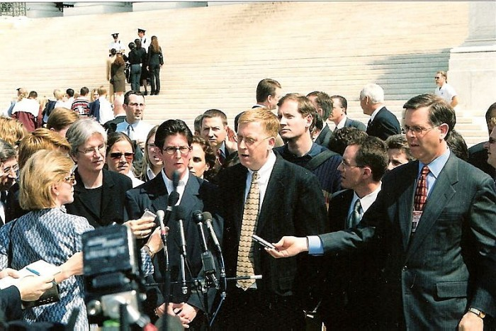 Paul Smith wearing the lucky necktie, with Lambda Legal Defense Fund attorney Ruth Harlow on his right, after arguing the case before the Supreme Court, 2003.