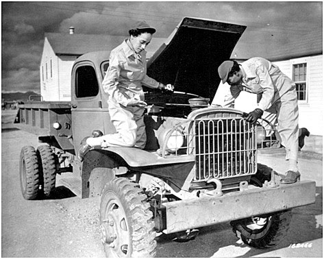 The U.S. Women's Army Corps (WAC) was largest of the women's branches in the American armed forces in WWII. In this photo of 8 December 1942, WACs Ruth Wade and Lucille Mayo, who had learned how to service trucks at the WAC training center, Fort Des Moines, Iowa, put their skills into practice at Fort Huachuca, Arizona. (Reproduction no. 111-SC-16246, National Archives and Records Administration, Washington, DC).