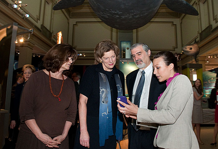 NMNH Online Community Manager Maggy Benson demonstrates the Amazing Ocean Mobile App developed jointly by the State Department and NMNH during the signing  ceremony for the State-Smithsonian MOU in March 2012. From left, NMNH Senior Scientist Nancy Knowlton; Former Ambassador to South Korea Kathleen Stephens; Under Secretary for History, Art, and Culture Richard Kurin, Maggy Benson.