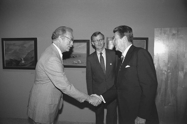 """President Ronald Reagan meets with Harry Lowe, Acting Director, National Museum of American Art, now the Smithsonian American Art Museum, and John F. Jameson, Assistant Secretary for Administration while at the NMAA exhibition, """"George Catlin: The Artist and the American Indian."""" (Photo by Kim Nielsen, as featured in The Torch, September, 1981)"""