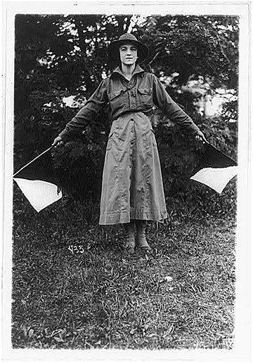 "Even before the United States became a belligerent, American women had begun to prepare themselves for war service by volunteering to train in uniformed patriotic organizations. In this 1916 photo, a ""wig wag girl"" in the US Women's Defense League practices signaling at a camp near Washington, DC. (Library of Congress Prints and Photographs Division, Washington DC. LC-USZ62-69471)"