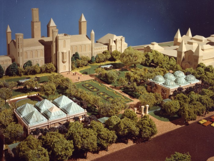 "A photograph of the model of the Quadrangle, a complex of buildings that contain the Sackler Gallery, National Museum of African Art, S. Dillon Ripley Center, and the South Yard behind the Smithsonian Institution Building, or ""Castle,"" and the Arts and Industries Building. The project of building the Quadrangle was begun in 1979. Opened in 1987, the complex, with three stories underground, is covered by the Enid A. Haupt Garden."