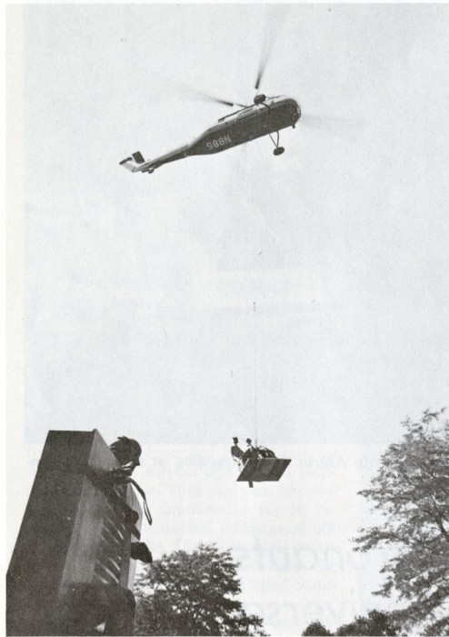 "At the Hirshhorn home in Greenwich, Connecticut, a helicopter lifts Henry Moore's ""King and Queen."" In the foreground is ""Man Pushing the Door"" by Jean Ipousteguy. ""King and Queen"" was delivered to the Hirshhorn Museum and Sculpture Garden on August 5, 1974."