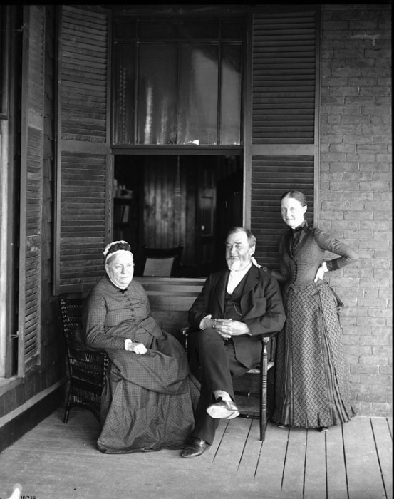 Spencer Fullerton Baird (1823-1887), second Secretary (1878-1887) of the Smithsonian with his wife, Mary (left), and daughter, Lucy (right), on the porch of their house in Woods Hole, Massachusetts, where Baird established the United States Fish Commission Station in 1875