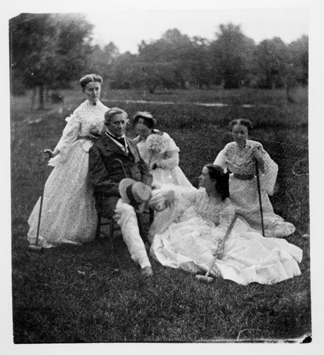Joseph Henry, first Secretary of the Smithsonian Institution (1846-1878), and his wife, Harriet Alexander Henry, and their daughters Caroline, Helen Louisa and Mary Anna, who are holding croquet mallets, seated on the grounds of the Smithsonian Institution Building. (Photo by Titian Ramsey Peale, 1865)