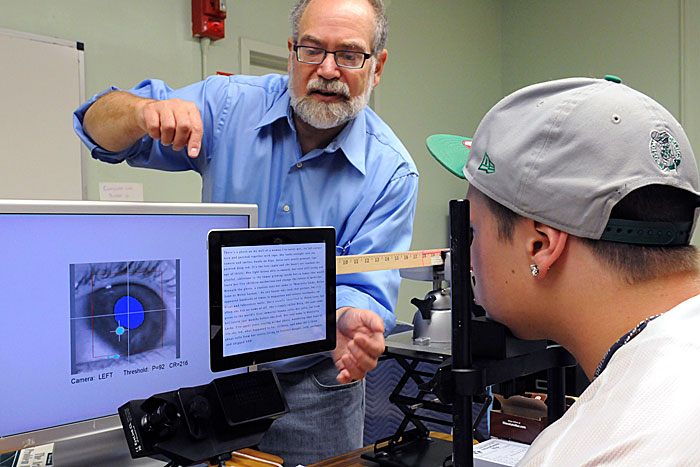 Matthew H. Schneps studies the eye movements of a Landmark High School student using an e-reader. (Photo: Copyright © 2012 Randy H. Goodman)