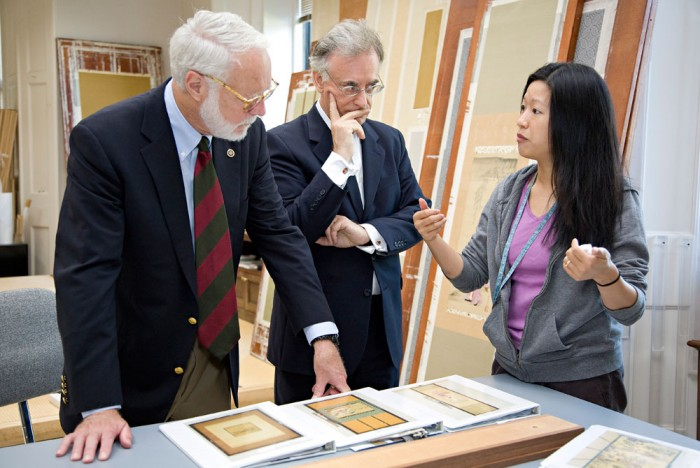 Smithsonian Secretary G. Wayne Clough, left, and Freer and Sackler Galleries Director Julian Raby, center, learn from Japanese Painting Conservator Regina Belard, right, about Asian art conservation at the museums on Aug. 8, 2008. (Photo by Ken Rahaim)