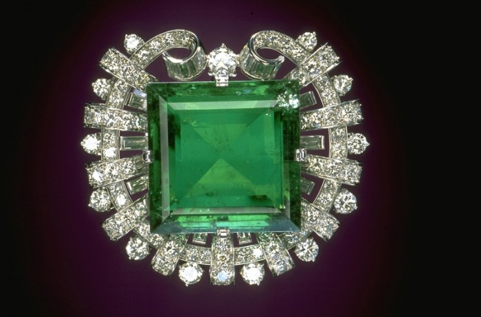 """This superb 75.47-carat Colombian emerald was once the property of Abdul Hamid II, Sultan of the Ottoman Empire (1876-1909), who according to legend, wore it in his belt buckle. Tiffany & Co. purchased the emerald at auction in 1911 and initially set it into a tiara, featured in the New York World's Fair """"House of Jewels"""" exhibit in 1940. In 1950, it was mounted in its current brooch setting and was featured on the first page of the Tiffany Christmas catalogue. In its platinum setting, the Hooker Emerald is surrounded by 109 round brilliant and 20 baguette cut diamonds, totaling approximately 13 carats. The Hooker Emerald is a beveled square-cut gem that exhibits exceptional color and clarity for an emerald of its size. The stone originated from the famous mines of Colombia and probably was shipped to Europe by Spanish conquistadores in the 16th or 17th century. Mrs. Janet Annenberg Hooker purchased the brooch from Tiffany in 1955, and in 1977 she donated it to the Smithsonian. The Hooker Emerald is on display in the Gem Gallery at the National Museum of Natural History. - See more at: http://geogallery.si.edu/index.php/en/1004911/hooker-emerald#sthash.e14bsusv.dpuf"""