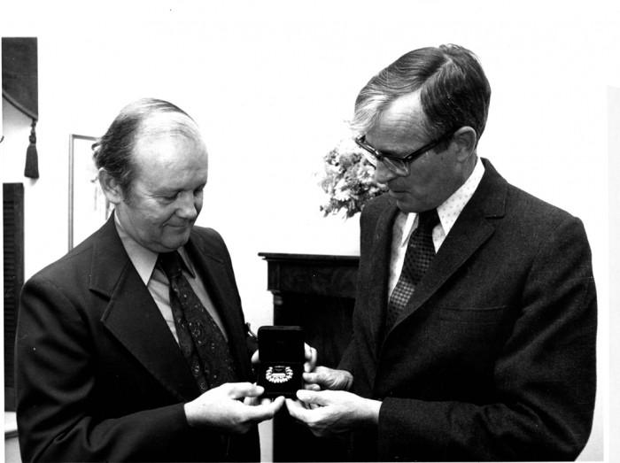 National Museum of Natural History Director Porter Kier (1973-1979), right, and Curator of Minerals Paul E. Desautels admire a seventy-five carat emerald which was presented to the Smithsonian Institution by Mrs. Stewart Hooker of New York