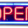Neon sign saying open