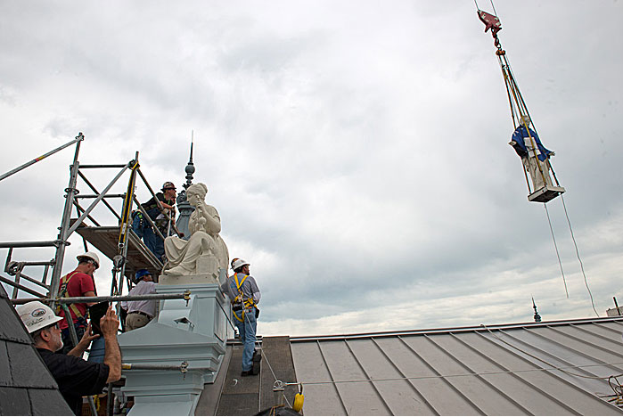 The Columbia statue is replaced on top of the A&I Building. (Photo by Mark Avino)
