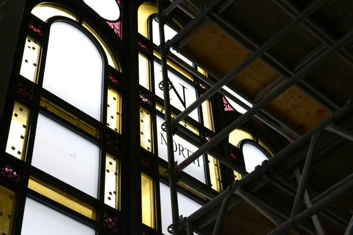 The compass markings Adolf Cluss designed to appear on the building's original stained glass windows were restored in this renovation. (Photo by  Brendan McCabe, Smithsonian Magazine)
