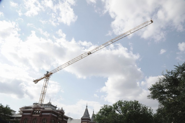 A crane is suspended above the A&I Building. (Photo by Chris Lethbridge)