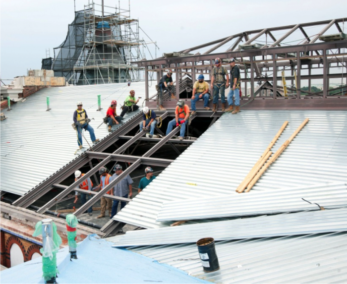 Workers replace the roof of the Arts & Industries Building. (Photo by Chris Lethbridge)