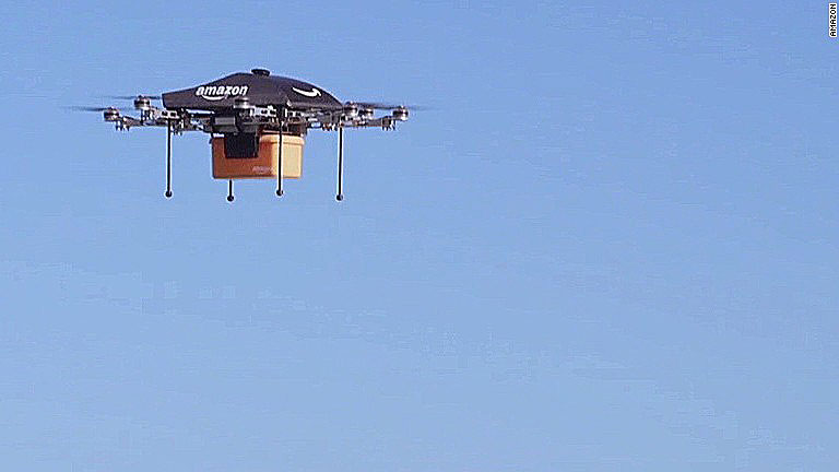 An Amazon Prime Air drone prototype delivering a package. (Photo courtesy Amazon.com)
