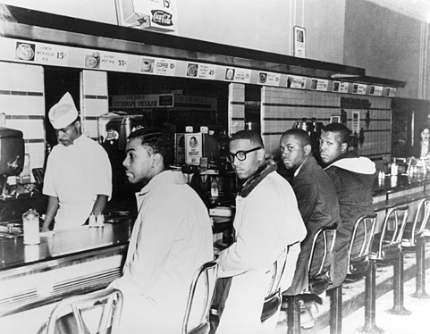 On the second day of the Greensboro sit-in, (from left) Joseph A. McNeil and Franklin E. McCain are joined by William Smith and Clarence Henderson at the Woolworth lunch counter in Greensboro, N.C. (Image courtesy of Greensboro News and Record).