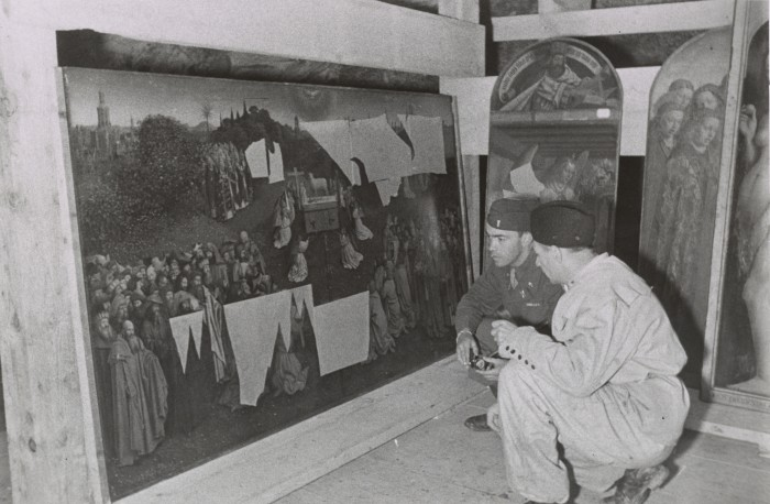 Lt. Daniel J. Kern and German conservator Karl Sieber examining Jan van Eyck's Adoration of the Mystic Lamb, also known as the Ghent Altarpiece (1432). Thomas Carr Howe papers, Archives of American Art, Smithsonian Institution
