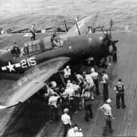 """The only known VB-92 Helldiver to be photographed up close, """"215"""" flown by Ensign Bob Sobey, illustrates the geometric symbol scheme of the squadron's early days on USS Lexington. (Photo courtesy of Robert L. Lawson Photograph Collection, National Naval Aviation Museum)"""