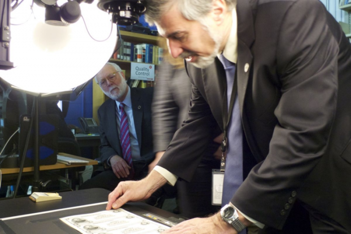 Even Smithsonian Secretary Dr. Wayne Clough and Dr. Richard Kurin, Under Secretary for History, Art, and Culture, stopped by to see the process—and got put to work. Photo by Günter Waibel.
