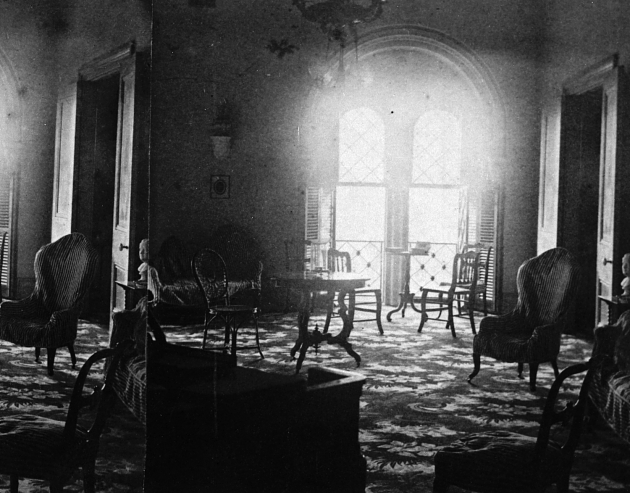 "The first Secretary of the Smithsonian, Joseph Henry (1846-1878) and family lived in the East Wing of the Smithsonian Institution Building. The Music Room of the Henry apartments is furnished with Rococo Revival and wicker furniture. The bust of George Washington can be seen on the far right. Photo by Titan Ramsey Peale, 1862, from ""The Castle: An Illustrated History of the Smithsonian Building"" by Cynthia R. Field, Richard E. Stamm, and Heather P. Ewing"