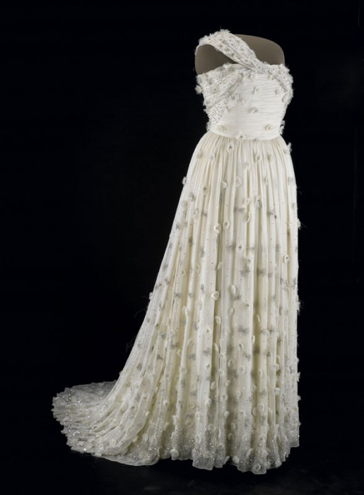 Michelle Obama wore this one-shouldered white silk chiffon gown embellished with organza flowers with Swarovski crystal centers to the 2009 inaugural balls. It was designed by Jason Wu. No details of the dress were released before the balls and Wu did not know that Mrs. Obama had selected his design, which he intended to symbolize hope, until he saw it on television. With the gown, Mrs. Obama wore shoes by Jimmy Choo and diamond earrings, bracelets and a ring designed for her by Loree Rodkin. (Photo courtesy National Museum of American History)
