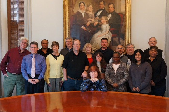 Front row: (seated) Janet Publicover (retired). Middle row, from left:  David Voyles (director), Merry Blount, John Clark, Pauline Thomas, Revilee Young, Irene Kariampuzha, Carolyn Branson. Back row: Paul Hickey, Gary (Stone) Kelly, Ed Patrick, Denise Keough, Tim Donovan, Jay Kaveeshwar, George Thomas, Ken Johnson. Not pictured: Judy Brown-Fonger.