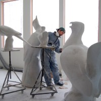 Artist Todd McGrain in his studio. His sculptures of of the Carolina parakeet, the Labrador duck, the great auk, the heath hen and the passenger pigeon will be on display in the Enid A. Haupt Garden through March 15, 2015. (Photo courtesy of The Lost Bird Project)