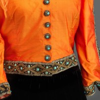 Button detail of Marian Anderson's orange and black outfit