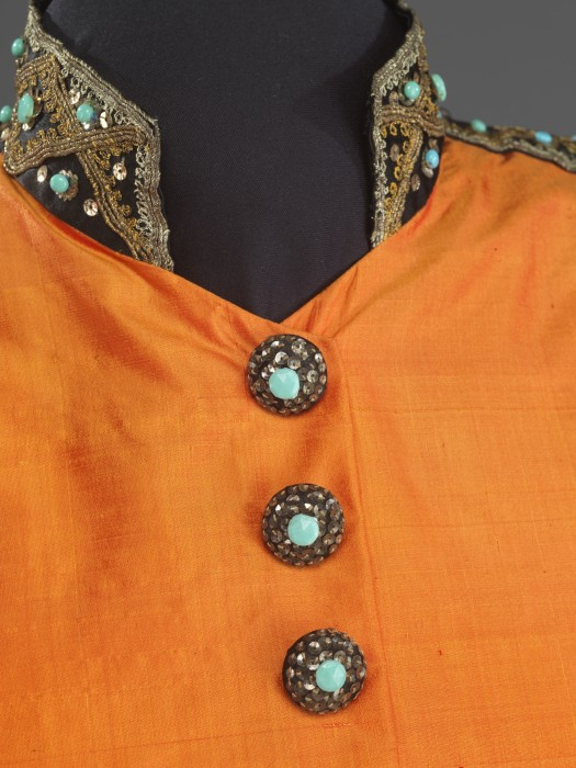Collar detail of Marian Anderson's orange and black concert ensemble