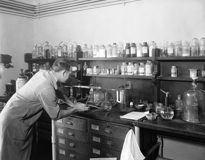 In a corner of the mineralogical laboratory in the Department of Geology at the United States National Museum, Edward Porter Henderson (1898-1992) conducts an experiment on a meteorite. (Photographer unknown, ca. 1930s, via Smithsonian Institution Archives)