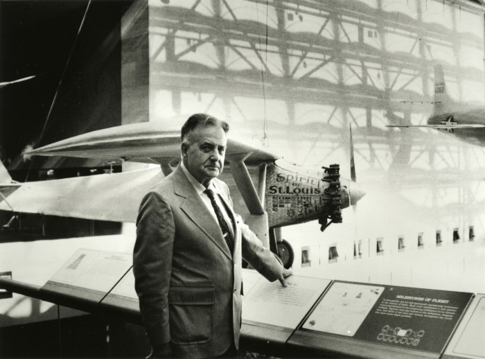 Paul E. Garber(1899 - 1992) poses in front of the Ryan NYP Spirit of St. Louis, soon after the new National Air and Space Museum (National Mall building) opened in 1976. Photograph is featured in National Air and Space Museum: An Autobiography