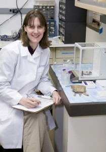 Christine France working with bone samples in her laboratory at the Smithsonian's Museum Conservation Institute. (Photo by Melvin Wachowiak, Jr.)