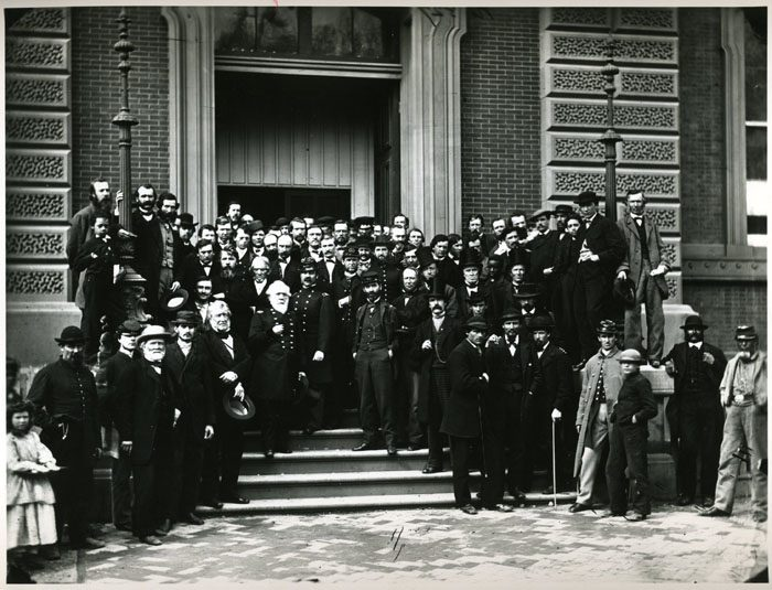 U.S. Quarter Master General staff members on the front steps of the building, 1865