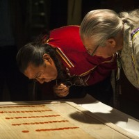 Faithkeeper of the Turtle Clan of the Onondaga Nation of the Haudenosaunee Confederacy Oren Lyons, Ph.D., (right), and The Tadodaho of the Haudenosaunee Confederacy Chief Sidney Hill, examine the signature of Ki-On-Twog-Ky, also known as Cornplanter (Seneca), on the Treaty of Canandaigua of 1794 at the Smithsonian's National Museum of the American Indian on Monday, Sept. 8, 2014 in Washington, D.C. (Photo by Kevin Wolf/AP Images for The Smithsonian's National Museum of the American Indian)
