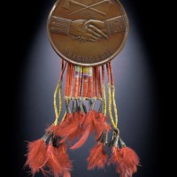 Thomas Jefferson peace medal, 1801, owned by Powder Face (Northern Inunaina / Arapaho), Oklahoma Bronze Copper alloy, hide, porcupine quills, feathers, dye, metal cones (Photo by Walter Larrimore)