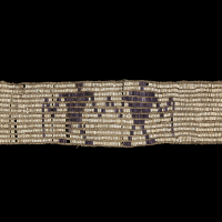 Wendat (Huron) wampum belt, 1600−50, Indian Territory (Kansas) Whelk shell, quahog shell, hide, bast fiber yarn, cordage (Photo by Ernest Amoroso)