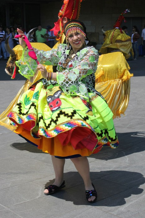 A dancer in traditional Bolivian dress