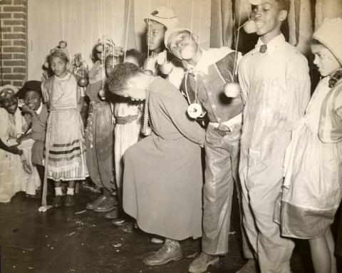 Children play a game with apples at a Halloween party at Frederick Douglass Community Center in Washington, D.C., sometime in the 1940s. Henry Bazemore Collection of Frederick Douglass Dwellings Photographs, Anacostia Community Museum Archives, Smithsonian Institution, gift of Henry Bazemore.