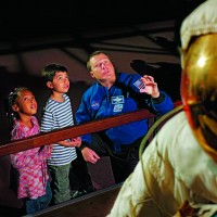 Young visitors to the National Air and Space Museum learn about space travel from an actual astronaut. (Photo by Eric Long)
