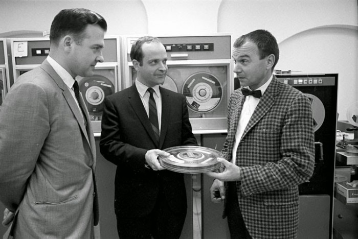 Nicholas Suszynski, Director of Sl's Information Systems Division, Reginald Creighton, senior systems analyst for the MNH computer project, and Dr. Donald Squires, Deputy Director of the Museum of Natural History, with a computer tape containing scientific data, 1968. Acc. No. 11-008, Smithsonian Institution Archives.