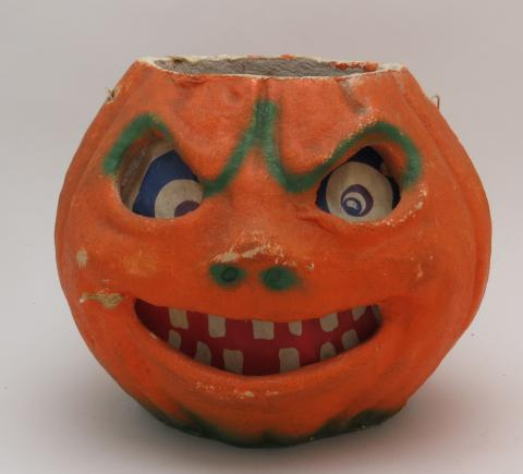 A ca. 1940 paper-mache jack-o'-lantern, used for decoration. Home and Community Life collection. 1992.3112.01.