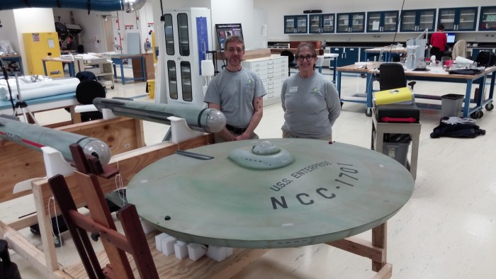Peter Flowers and Marilyn Small with the model of the Starship Enterprise at the Emil Buehler Conservation Laboratory. (Photo courtesy of Jen Zoon)