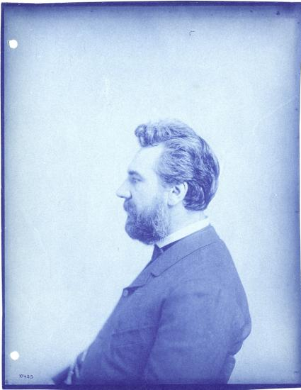 Left profile seated portrait of Alexander Graham Bell, ca. 1880s, via Smithsonian Institution Archives.