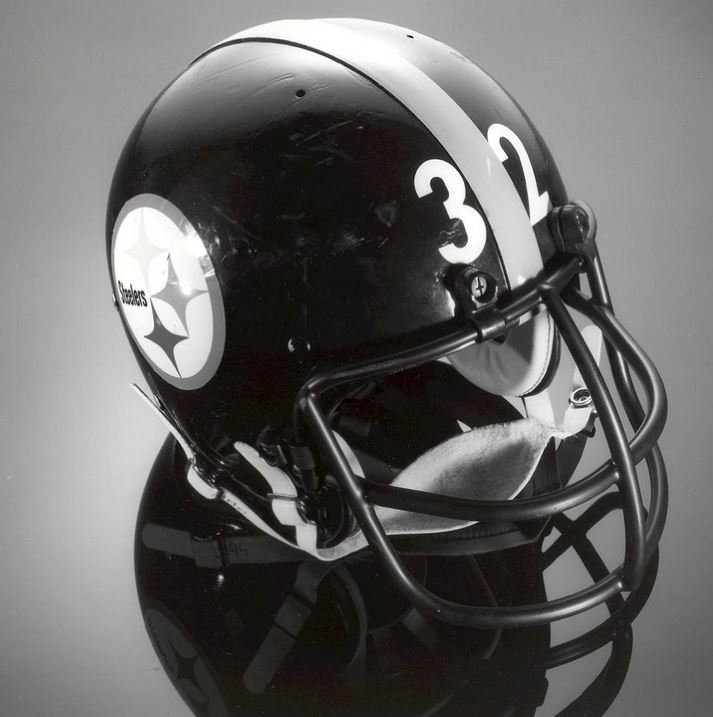 The helmet worn by Pittsburgh Steelers running back Franco Harris (b. 1950) in Super Bowl XIV, held in Pasadena, Calif. on Jan. 20, 1980. The Steelers won the game, defeating the Los Angeles Rams 31-19. Harris ran for 46 yards and two touchdowns, and caught 3 passes for 66 yards. From the collections of the American History Museum.
